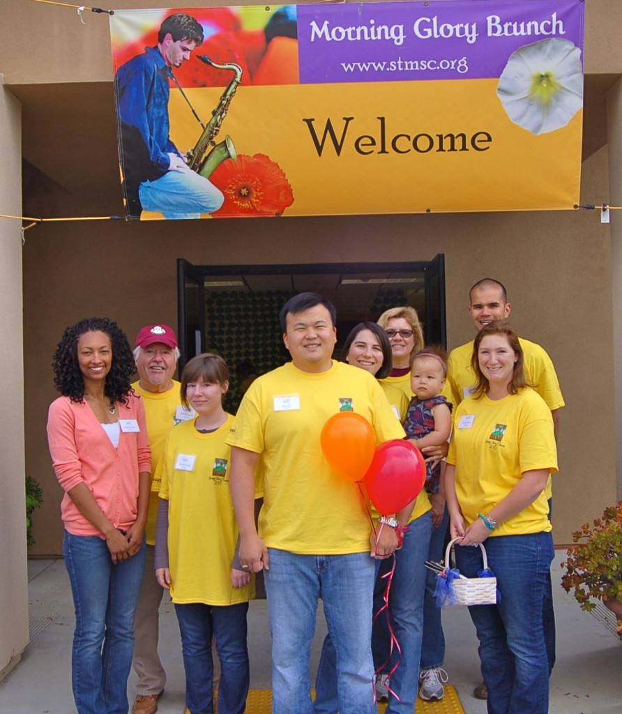 The morning shift of volunteers at Sophie's Center: (l-r) Jocelyne Campese '02, Bill McDonald '68, Julia McDonald x'12, Brian Tsu '00, Lissa Tsu '00 (holding Margot), Rebecca Reid '96, and Phil and Brianne Baxa '04. Some of these folks worked all day and others joined in the afternoon.