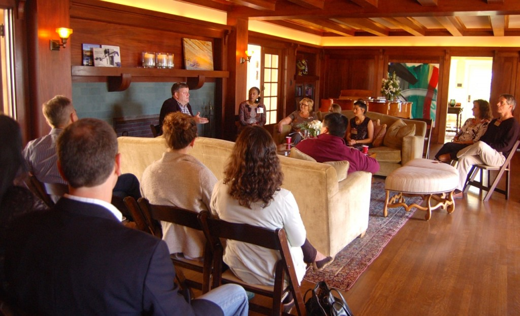 Terrence Devino, SJ, BC vice president and secretary, center rear, leads a book discussion for BC San Diego alumni.