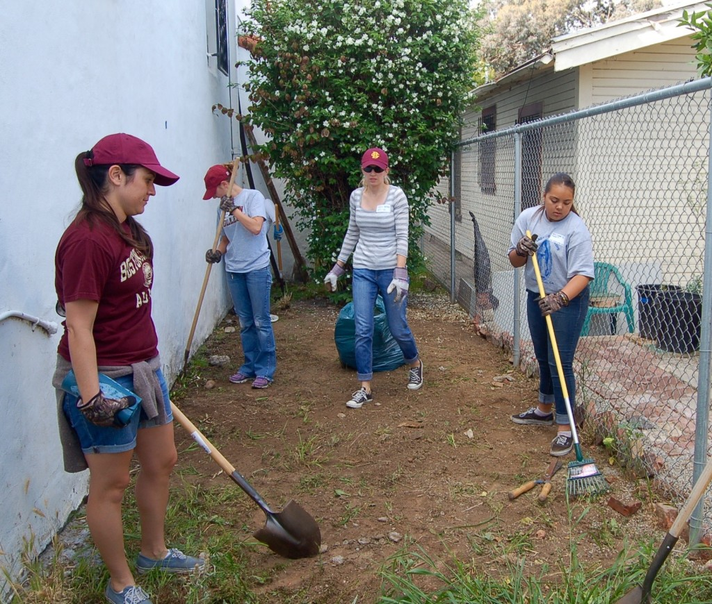 Weed whackers, from left: Katrina Vasquez '10, Erin Buss '09, a friend, and a high school student.