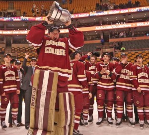 San Diego's Thatcher Demko holds aloft his second Beanpot in three years.